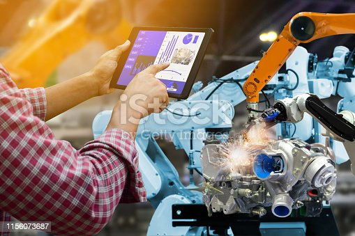 1022530836 istock photo Engineer touch screen control robot the production of factory parts engine manufacturing industry robots and mechanical arm 1156073687
