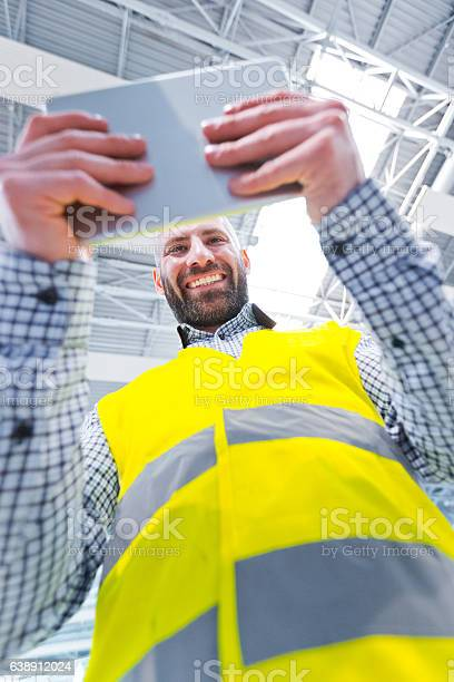 Engineer Using A Digital Tablet Low Angle View Stock Photo - Download Image Now
