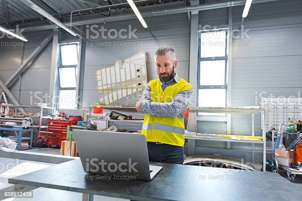 Engineer Using A Laptop At Work Stock Photo - Download Image Now