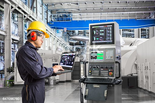 istock Engineer using computer for maintenance equipment in powerhouse 647096760