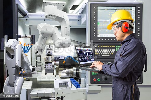 istock Engineer using laptop computer for maintenance automatic robotic arm with CNC machine in smart factory. Industry 4.0 concept 828306956