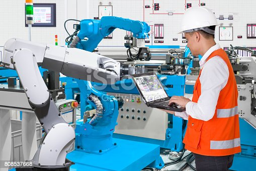 874298574 istock photo Engineer using laptop computer for maintenance automatic robotic hand machine tool at industrial manufacture factory, Industry 4.0 concept 808537668