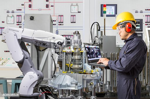 874298574 istock photo Engineer using laptop computer for maintenance automatic robotic hand machine tool in automotive industry 808538506