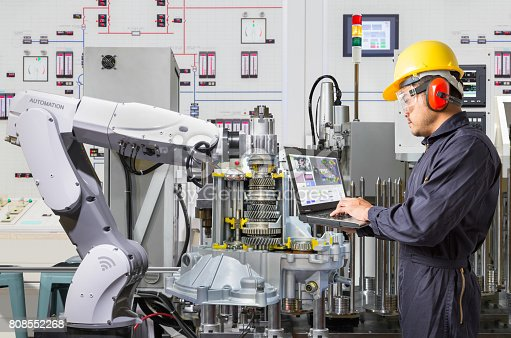 874298574 istock photo Engineer using laptop computer for maintenance automatic robotic hand machine tool in automotive industry 808552268