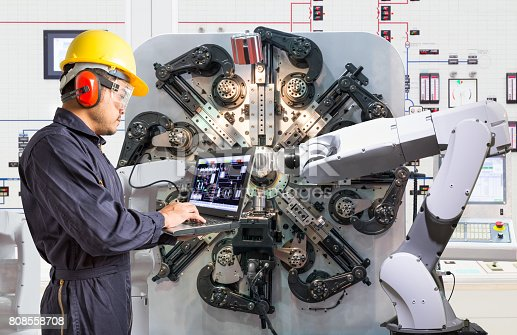 874298574 istock photo Engineer using laptop computer for maintenance automatic robotic hand machine tool at factory, Industry 4.0 concept 808558708