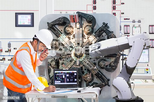 874298574 istock photo Engineer using laptop computer for maintenance automatic robotic hand machine tool at factory, Industry 4.0 concept 808566748