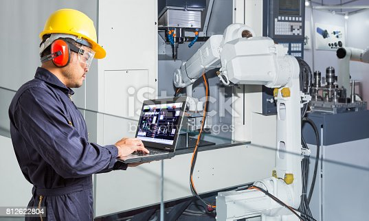 874298574 istock photo Engineer using laptop computer for maintenance automatic robotic hand machine tool in automotive industry 812622804