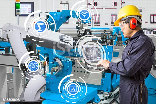 874298574 istock photo Engineer using laptop computer for maintenance automatic robotic hand machine tool at industrial manufacture factory 828309898