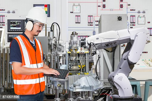 874298574 istock photo Engineer using laptop computer for maintenance automatic robotic hand machine tool in automotive industry 874301896