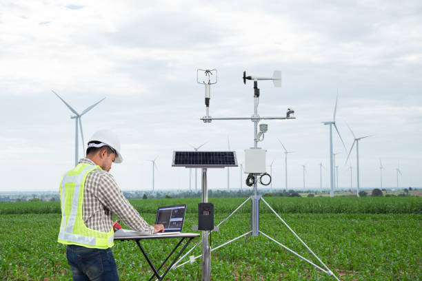 engineer using tablet computer collect data with meteorological instrument to measure the wind speed, temperature and humidity and solar cell system on corn field background, smart agriculture technology concept - weather stock photos and pictures