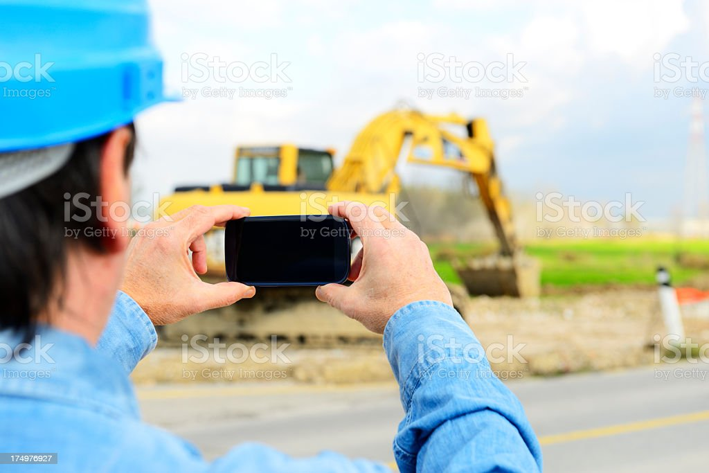 Engineer W Smart Phone in Construction Site royalty-free stock photo