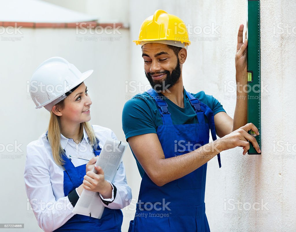 Engineer watching black specialist making wall plane stock photo
