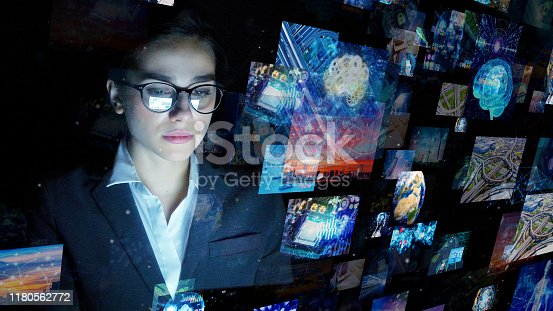 810397364 istock photo Engineer watching hologram screens. Visual contents. 1180562772