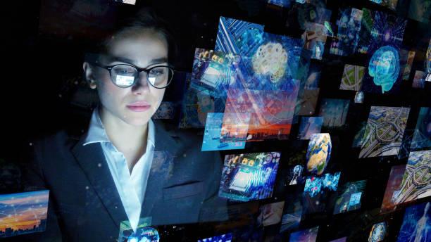 engineer watching hologram screens. visual contents. - business woman hologram imagens e fotografias de stock
