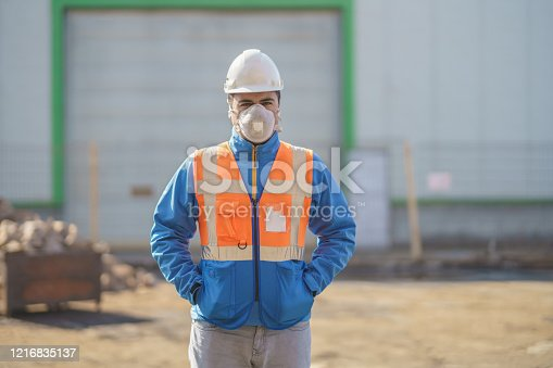 Engineer wearing gas mask outside the factory