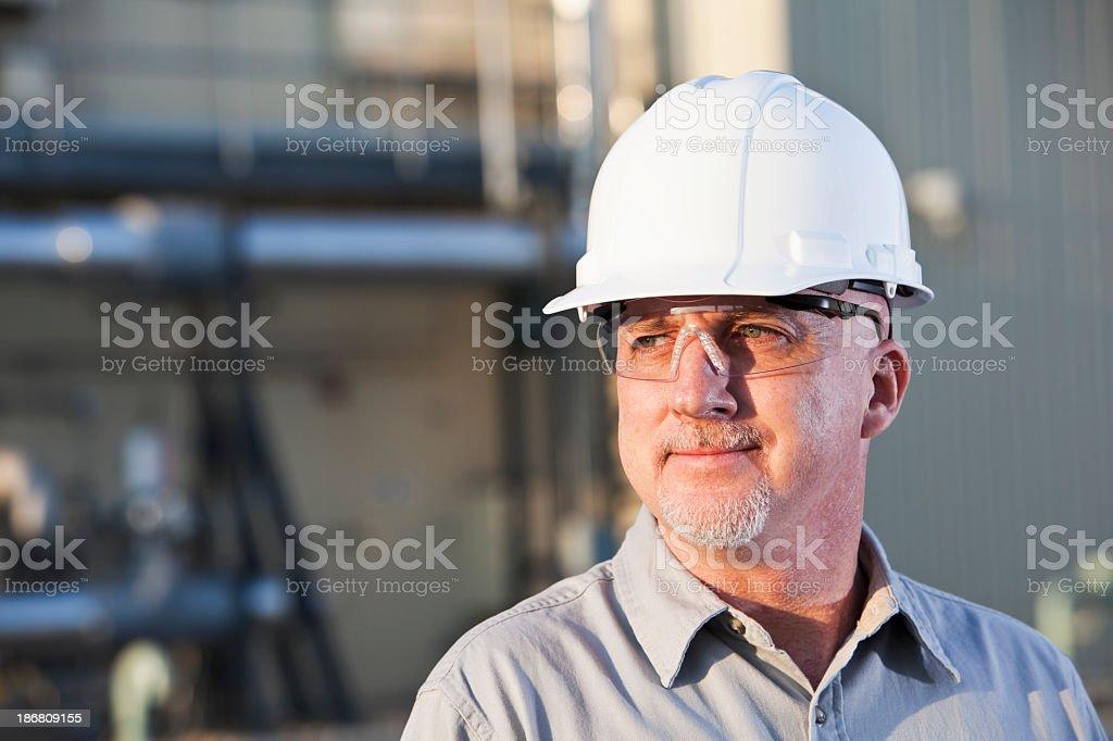 Engineer wearing hardhat stock photo