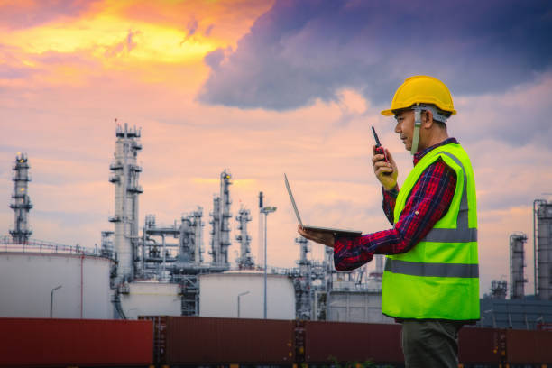 Engineer wearing safety helmet at oil refinery industry. stock photo