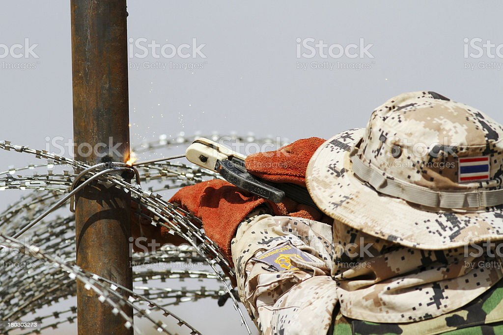 Engineer welding wire fence royalty-free stock photo