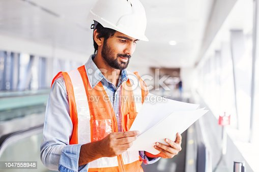 istock Engineer with contract 1047558948