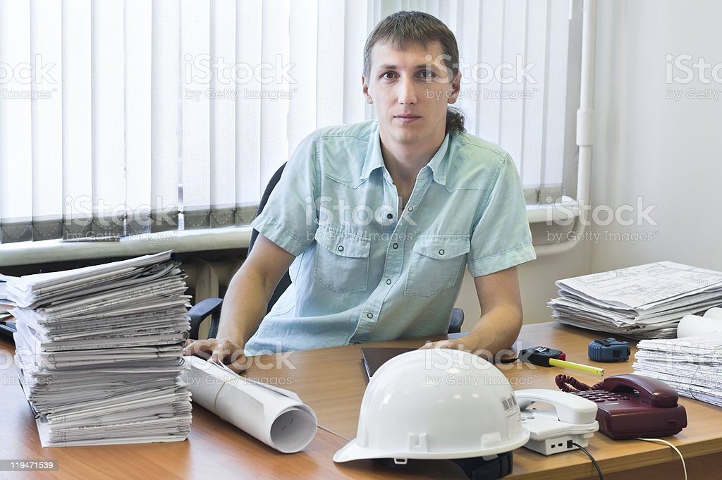 Engineer with design drawings in office royalty-free stock photo
