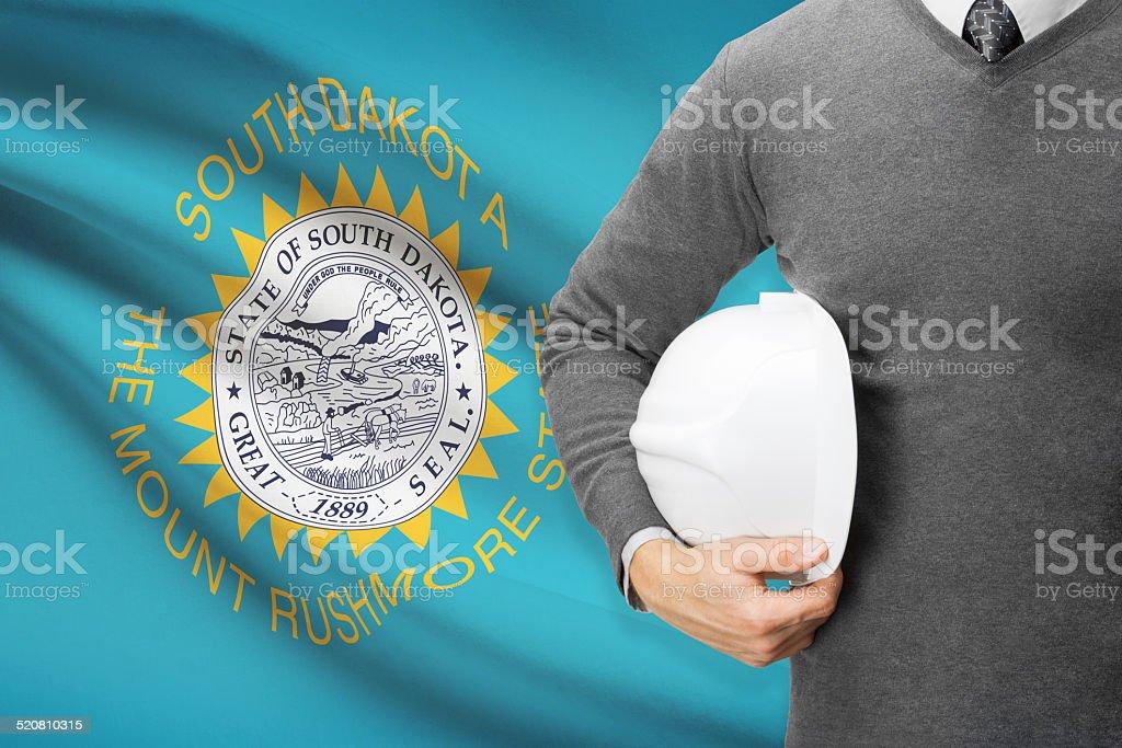 Engineer with flag on background series - South Dakota stock photo