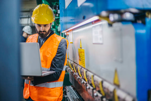 Engineer with laptop stock photo