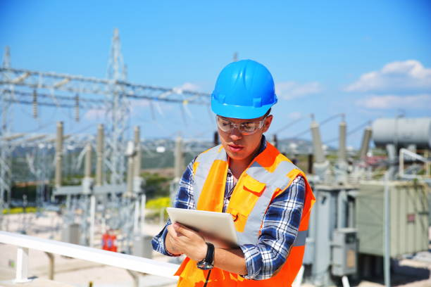 Engineer with tablet and Electricity stock photo