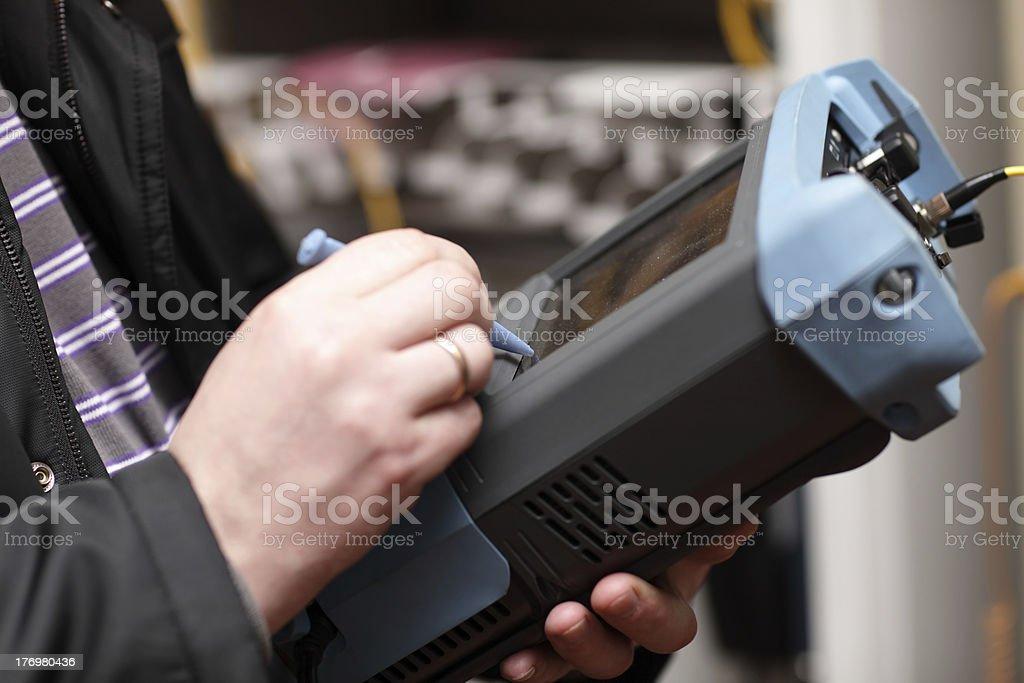 Engineer with telecom analyzer stock photo