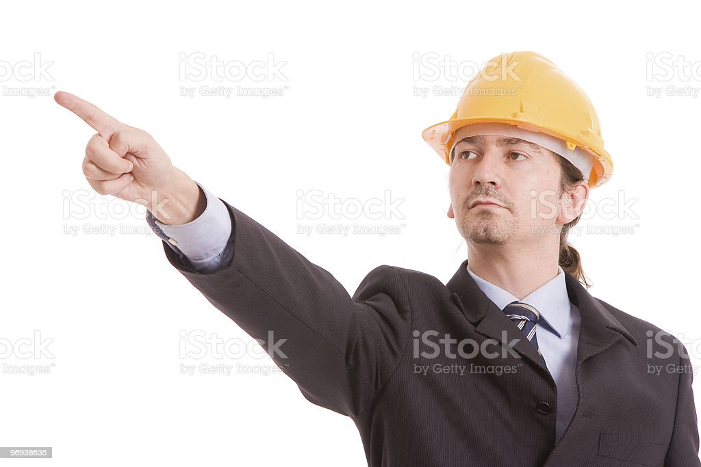 Engineer with yellow hat, pointing forward royalty-free stock photo