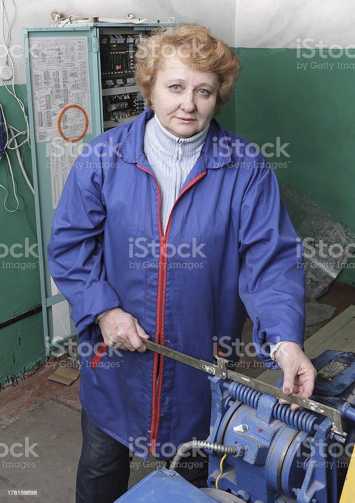 Engineer woman  in machine room (elevator). royalty-free stock photo