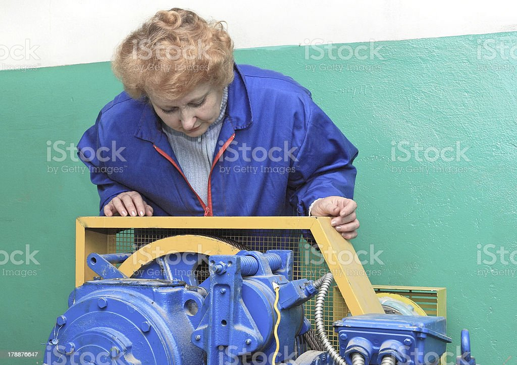 Engineer woman  in machine room (elevator). royalty-free stock photo