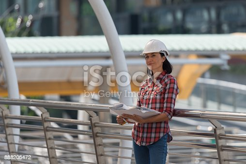 istock Engineer Woman russian checking the blueprints 888205472