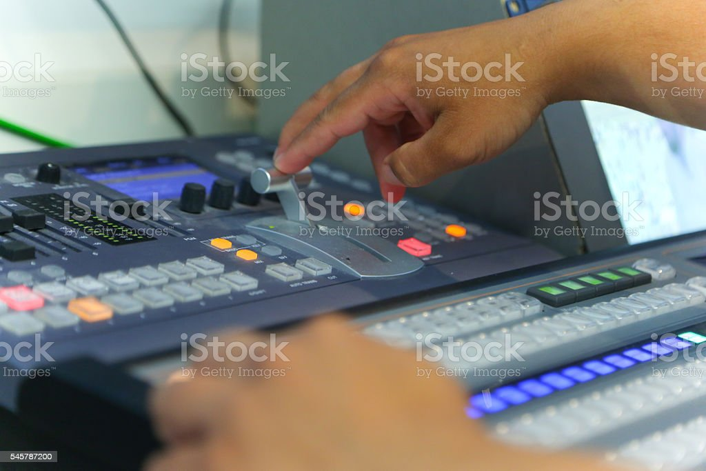 TV engineer working editing  with video and audio mixer stock photo