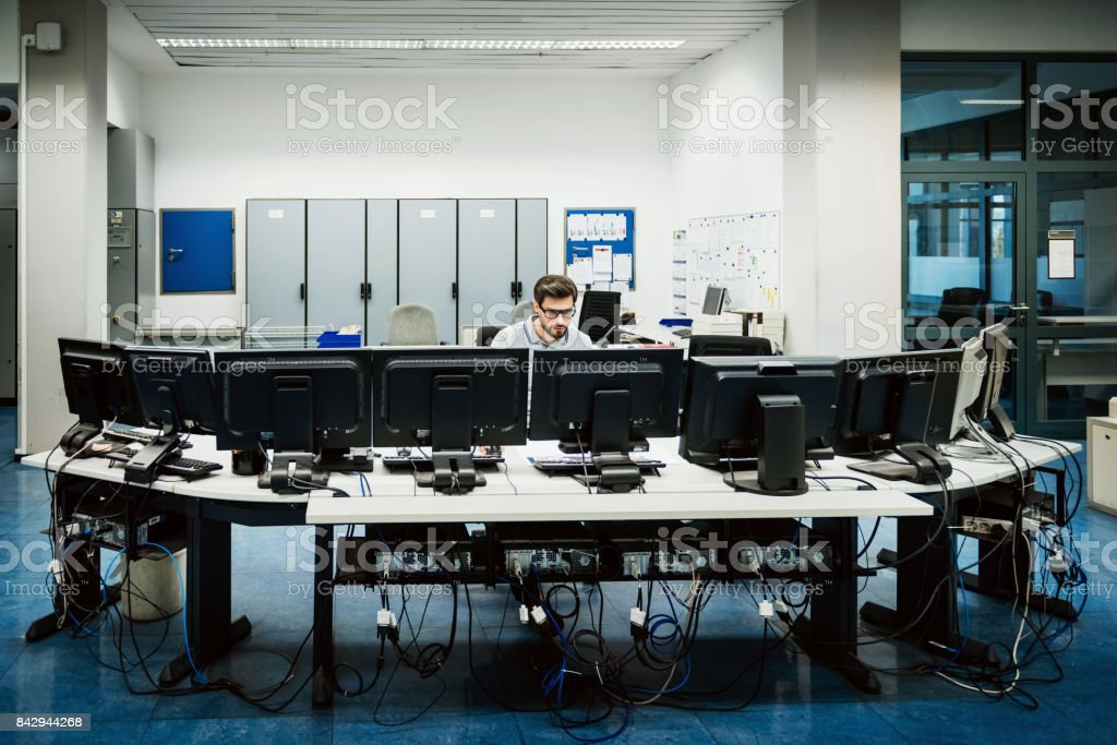 Engineer working in big control room stock photo