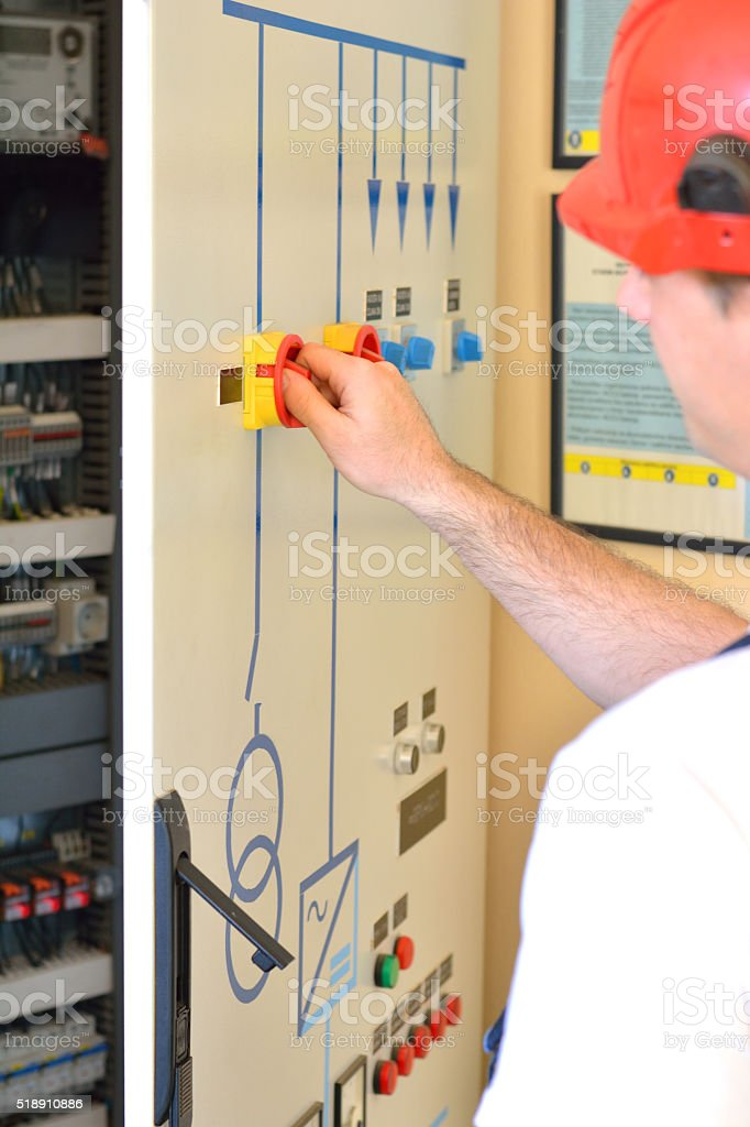 Engineer Working in the Power Substation stock photo