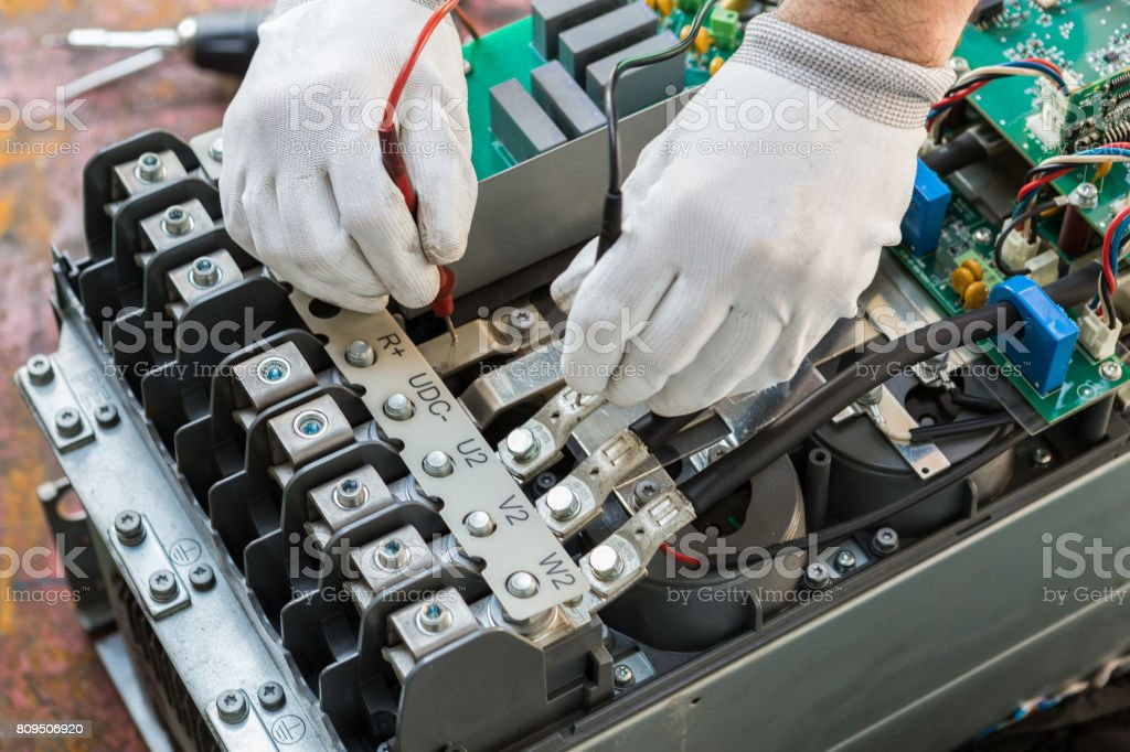 engineer working on checking and maintenance inverter and string monitor unit stock photo
