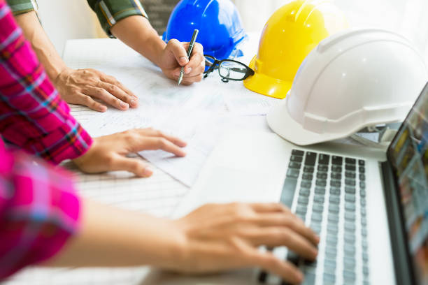 Engineer working on construction project. stock photo