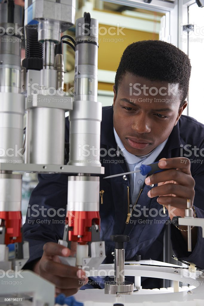 Engineer Working On Machine In Factory stock photo