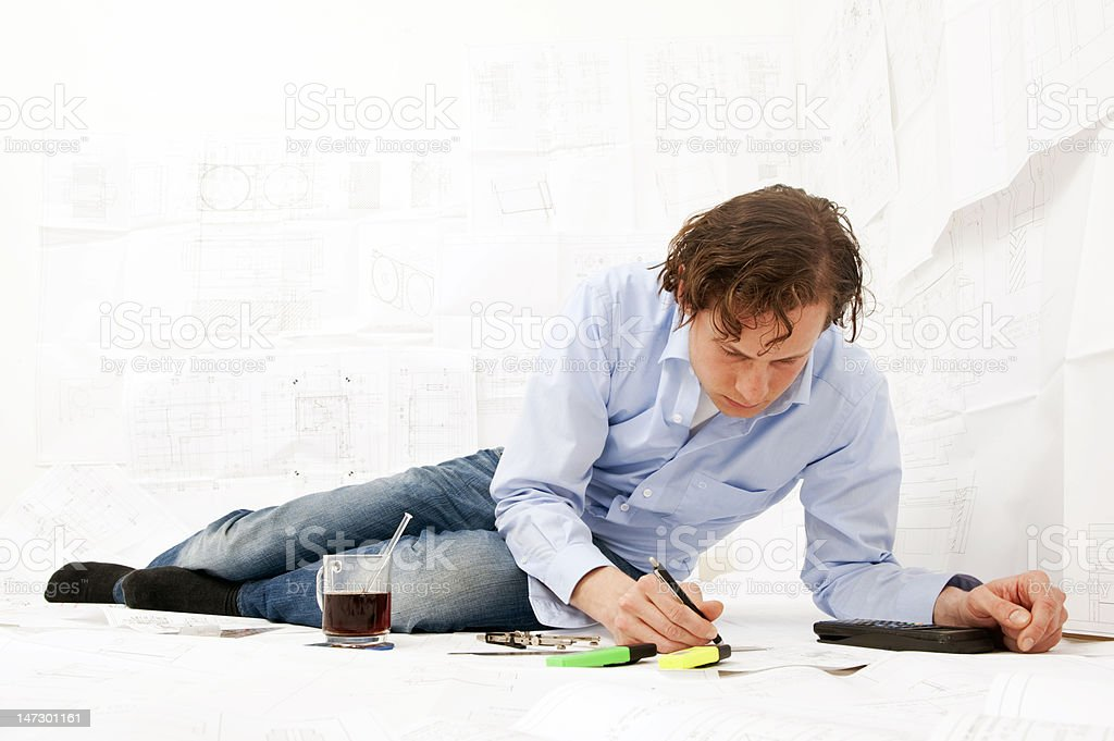 Engineer working overtime royalty-free stock photo