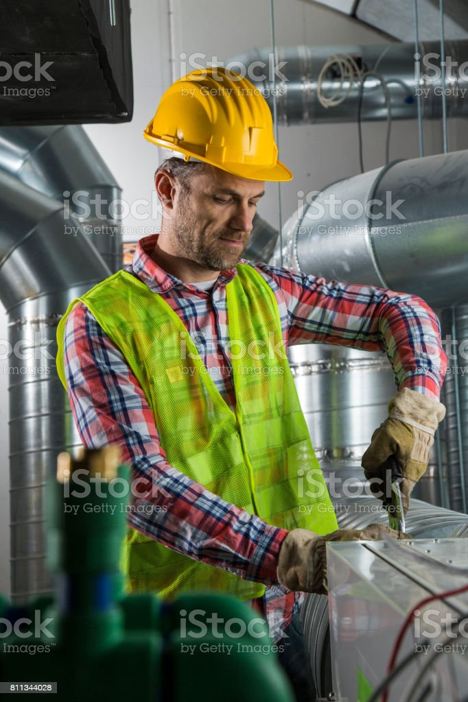 HVAC Engineer working royalty-free stock photo
