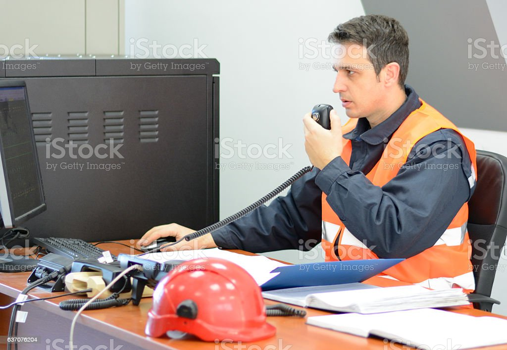 Engineer Working with Blueprints at the Desk stock photo