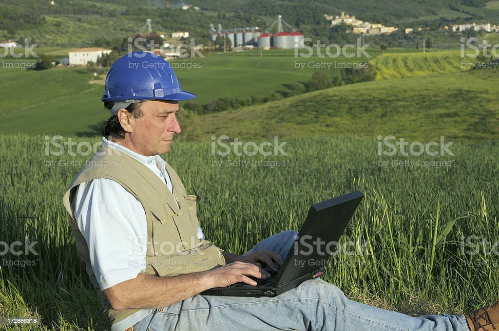 Engineer working with laptop royalty-free stock photo