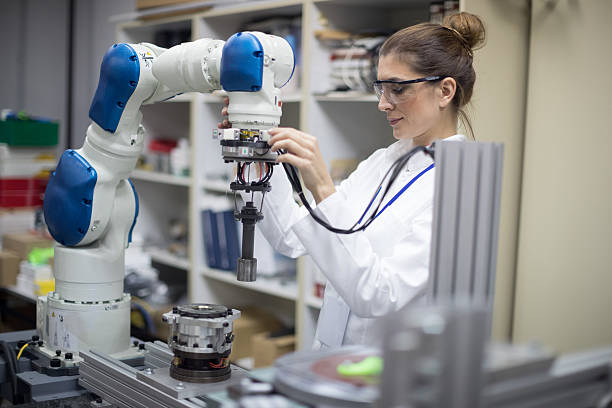 Engineer working with robotic arm stock photo