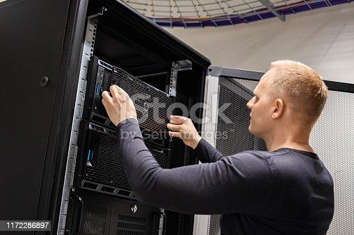 istock IT Engineer Working With Servers In Datacenter 1172286897