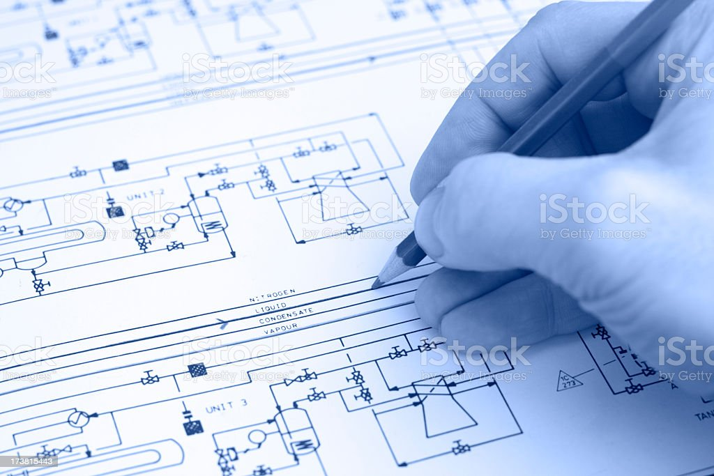 Engineer working with technical diagram of a gas storage facility. royalty-free stock photo