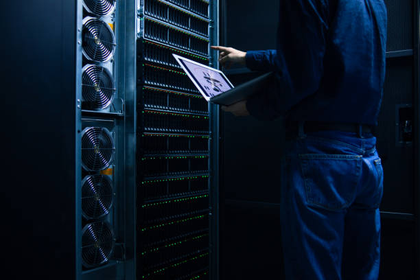Engineer working with topological graph in Server room stock photo