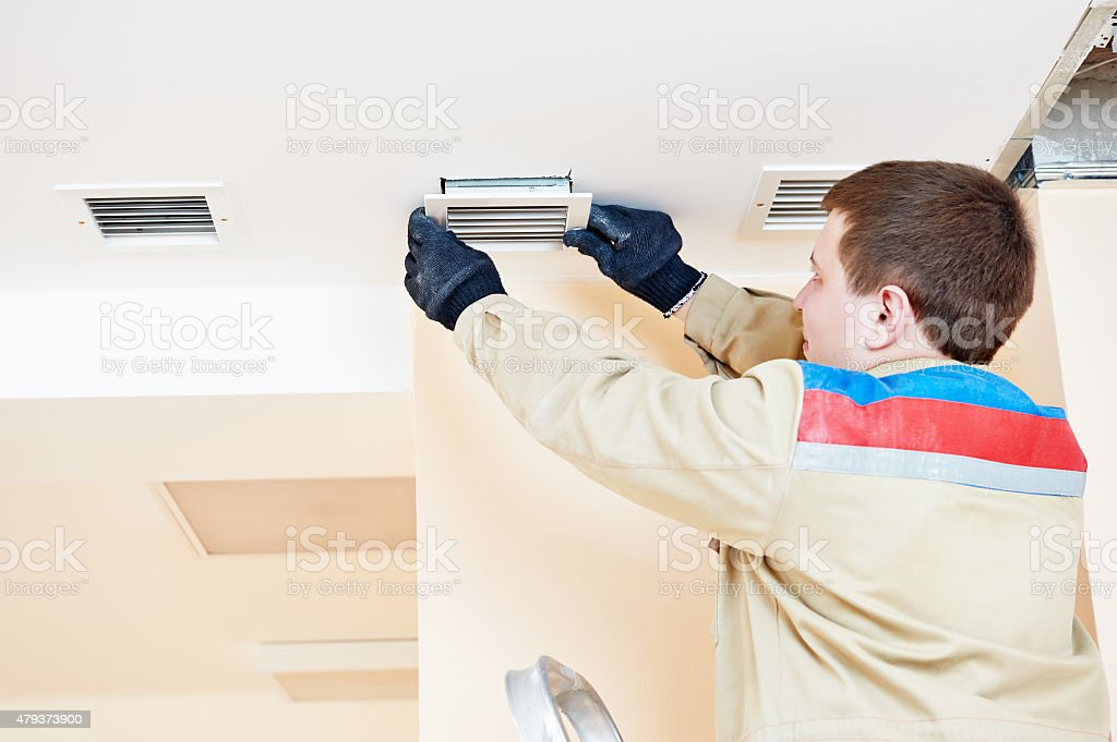 engineer works with ventilation stock photo
