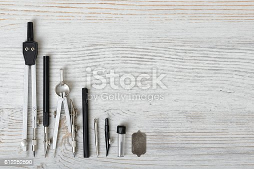 istock Engineering and school instruments are in a row. 612252590