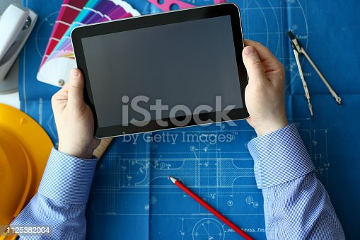 istock Engineering college student holds tablet 1125382004