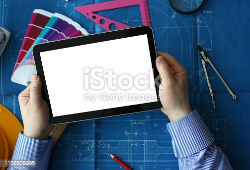 istock Engineering college student holds tablet 1126808995